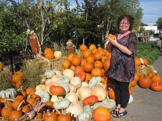 Mary with pumpkins at Merrifield Garden Center